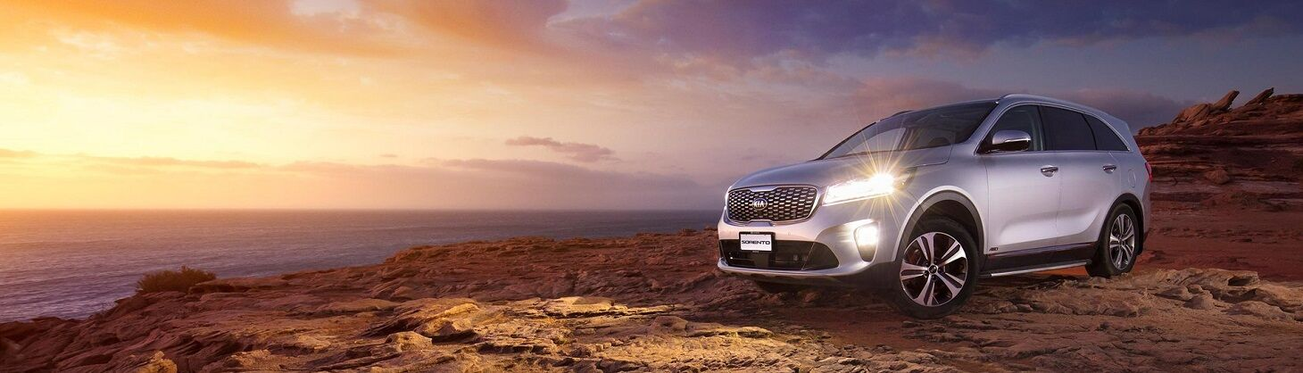 2019 Kia Sorento SUV on a hill with lights on