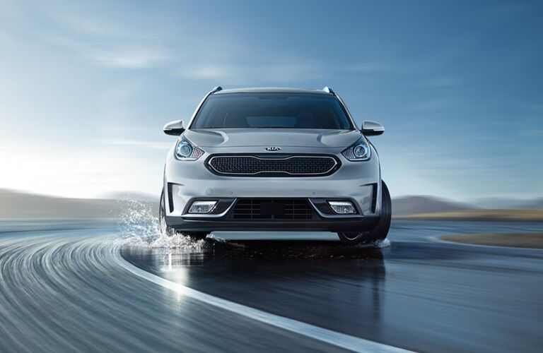 Front view of a 2019 Kia Niro driving through water