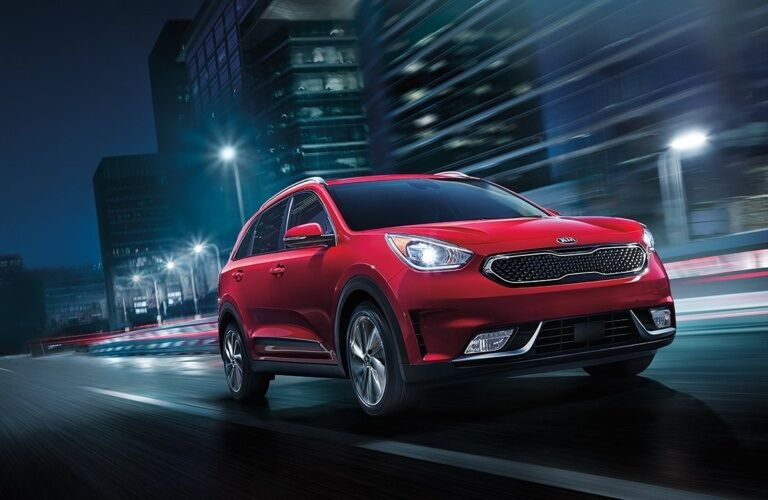 2019 Kia Niro driving through city at night