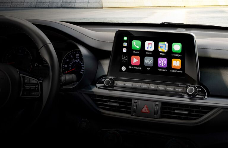 Interior front showcasing Apple CarPlay on the infotainment system in a 2020 Kia Forte.