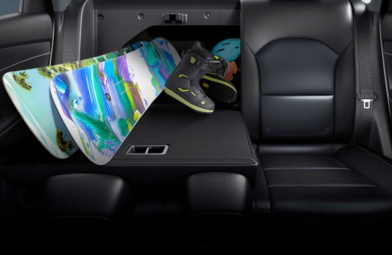 Snwoboard and other items stored inside the 2020 Kia Forte using the useful 60/40 rear seat fold-down feature.
