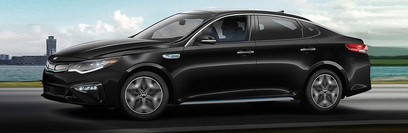 2020 Kia Optima Hybrid black exterior driver side slight front fascia driver inside