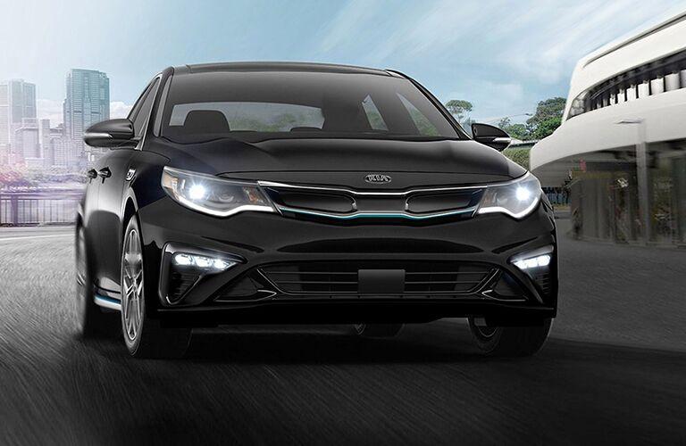 2020 Kia Optima Hybrid black exterior front fascia headlights on