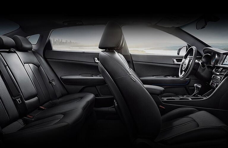 2020 Kia Optima Hybrid interior black front and second row seats dashboard side view