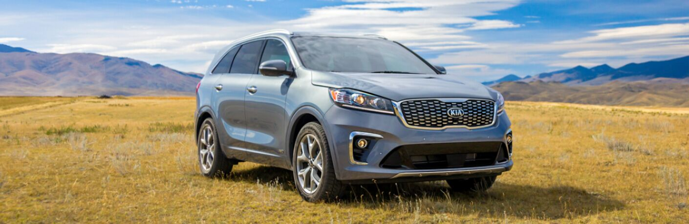 2020 Kia Sorento silver exterior front fascia passenger side in grass prairie and mountains in background