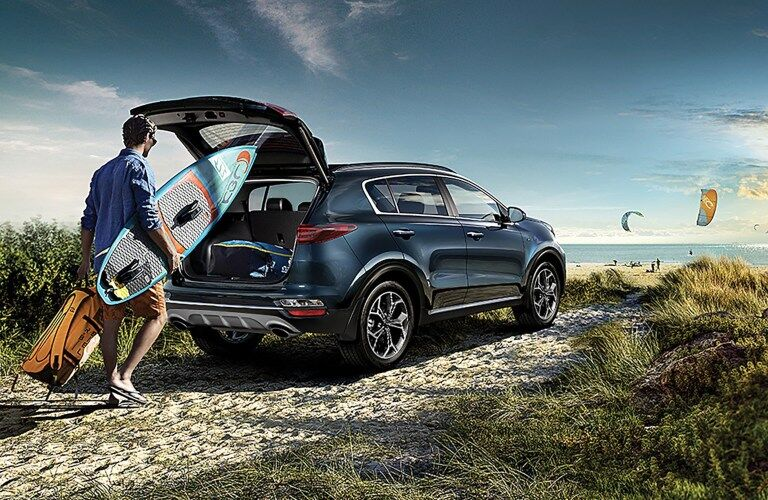 2020 Kia Sportage with tailgate open and man walking up