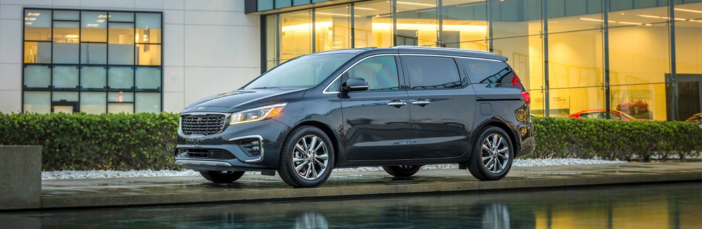 2019 Kia Sedona parked outside building