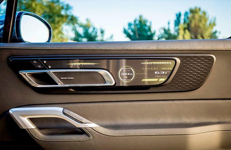 2020 Kia Telluride interior front passenger side door handle and controls