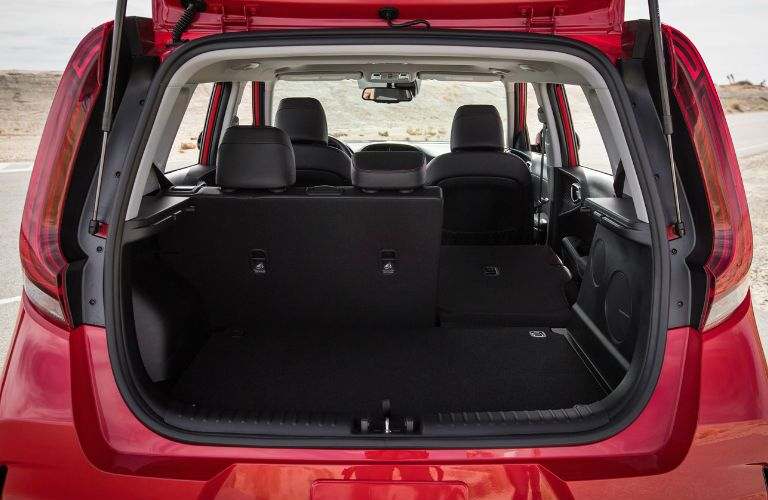 2021 Kia Soul red exterior rear open tailgate empty cargo space