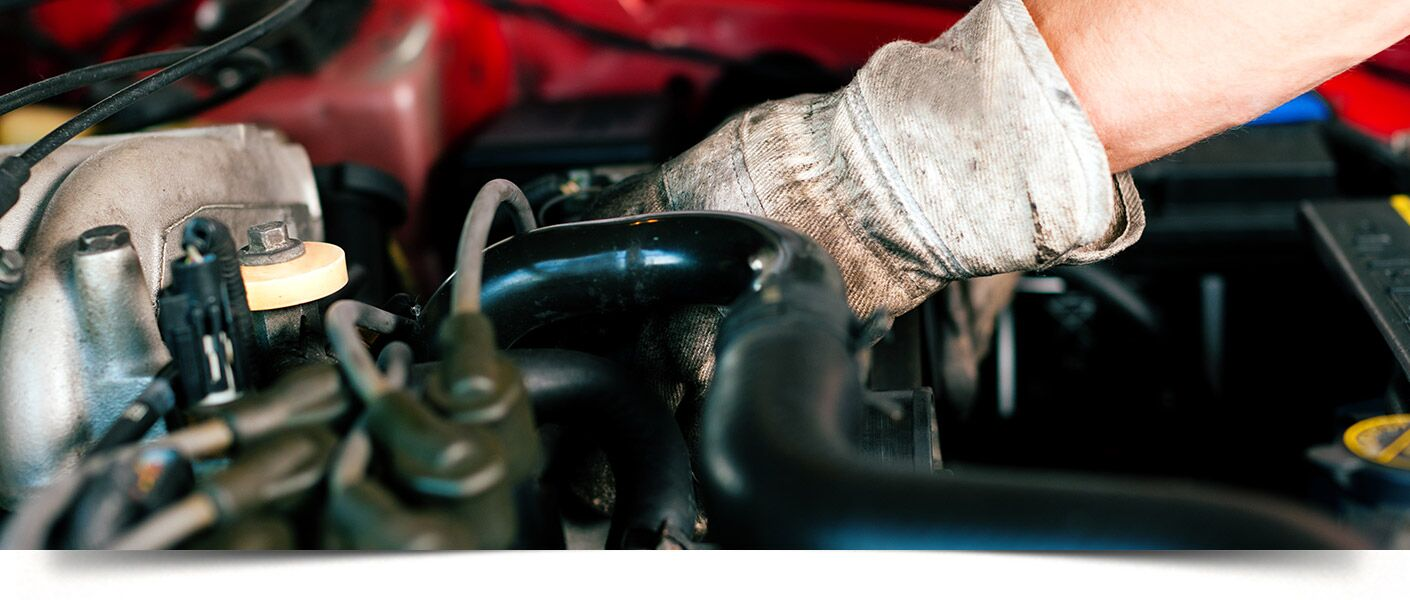 Mechanic working insides vehicles engine