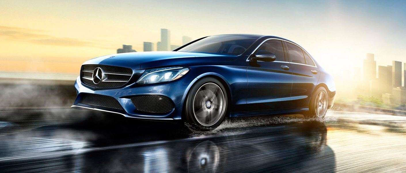 Blue 2017 Mercedes-Benz C-Class driving down the road