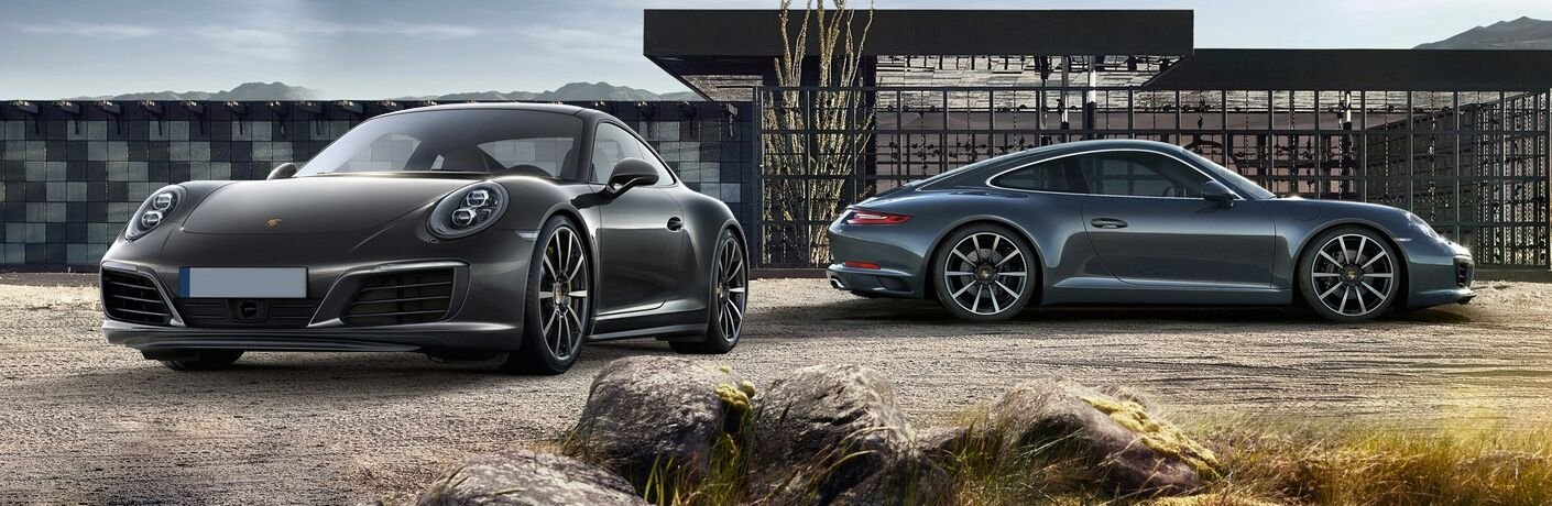 Exterior view of two 2017 Porsche vehicles parked in a desert location