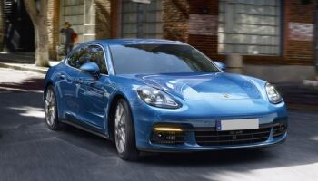 Exterior view of a blue 2017 Porsche Panamera parked on a city street