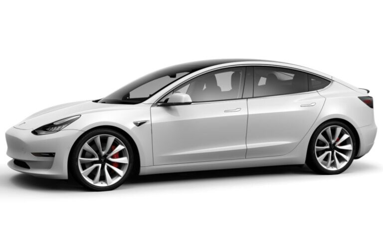 Exterior view of a white Tesla Model 3 parked against a white background