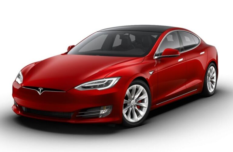 Exterior view of a red Tesla Model S parked against a white background