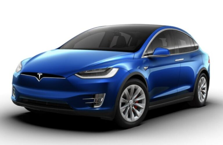 Exterior view of a blue Tesla Model X parked against a white background