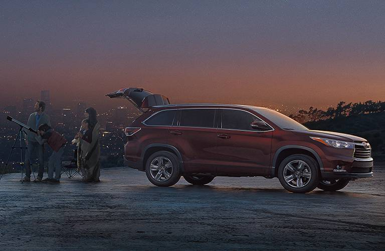 Red 2016 Toyota Highlander at Night