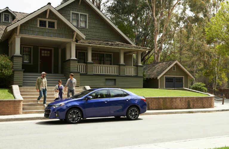 Blue 2016 Toyota Corolla Parked on Street
