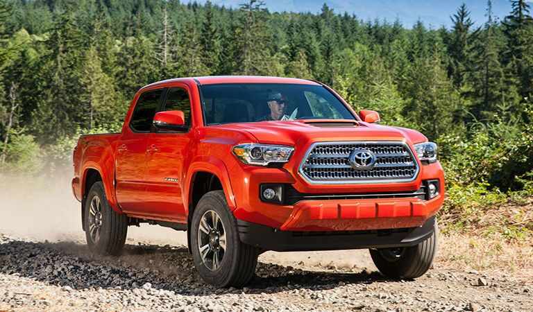 Orange 2016 Toyota Tacoma on the Trail