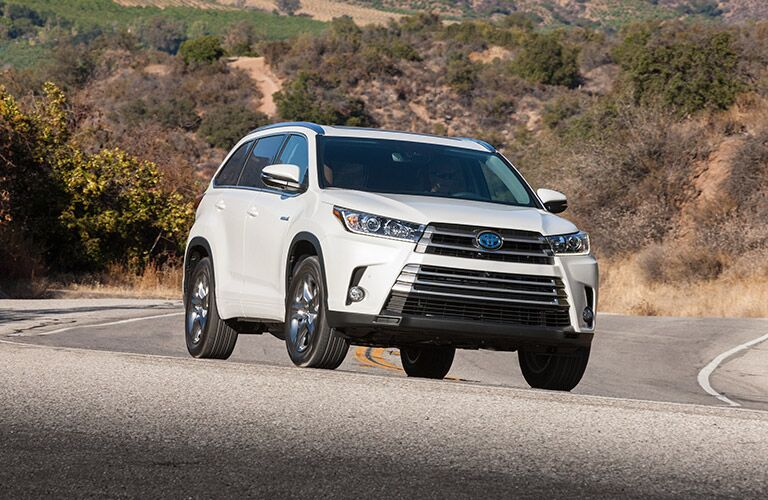 White 2017 Toyota Highlander Hybrid Front Exterior on Highway