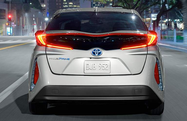 Silver 2017 Toyota Prius Prime Rear Exterior Driving on City Street at Night