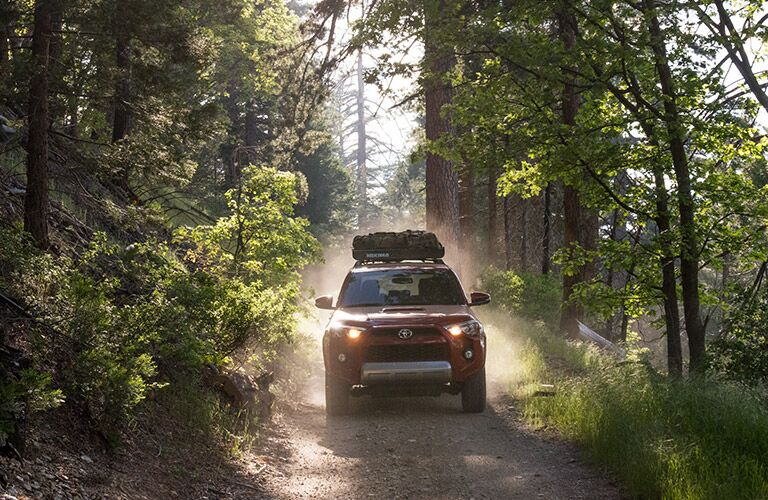 Red 2017 Toyota 4Runner Front on Wooded Trail