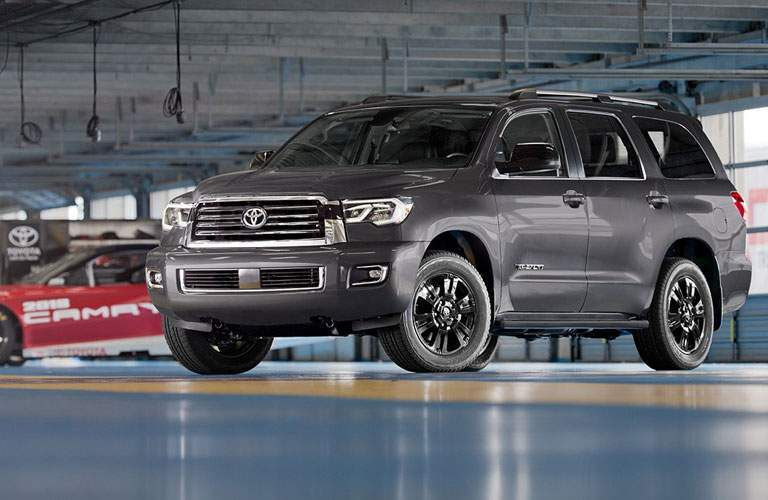 Gray 2018 Toyota Sequoia TRD Sport in Nascar Garage with Toyota Camry Race Car in background