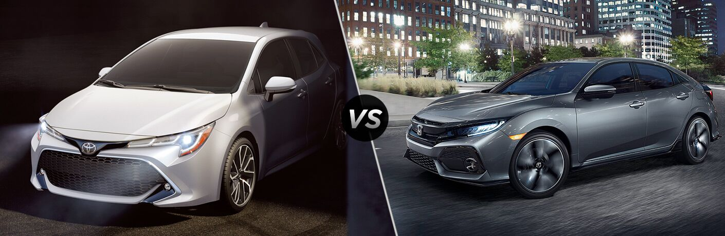 White 2019 Toyota Corolla Hatchback in Shadows vs Gray 2018 Honda Civic Hatchback on a City Street