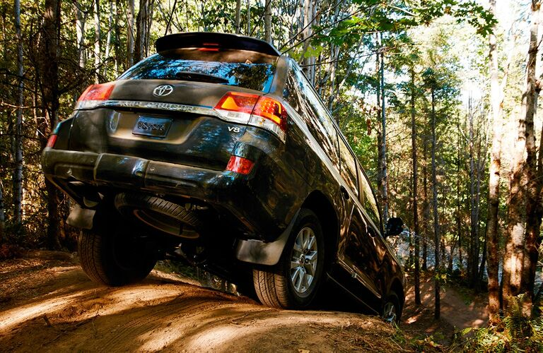 Black 2019 Toyota Land Cruiser Rear Exterior on Wooded Trail