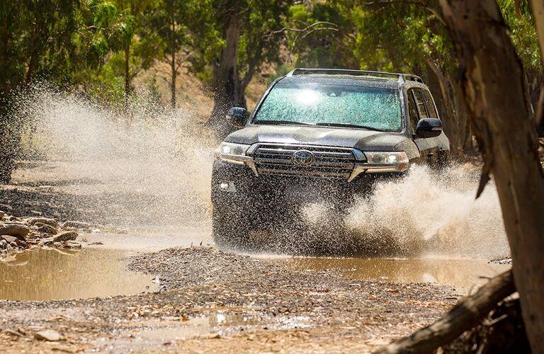 Black 2019 Toyota Land Cruiser in a Stream