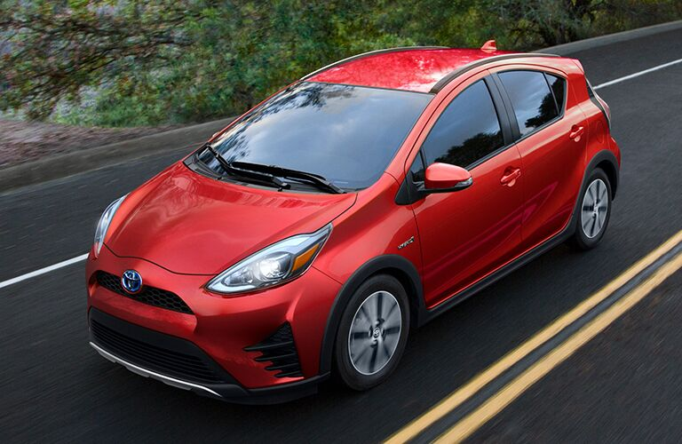 Red 2019 Toyota Prius c on a Country Highway