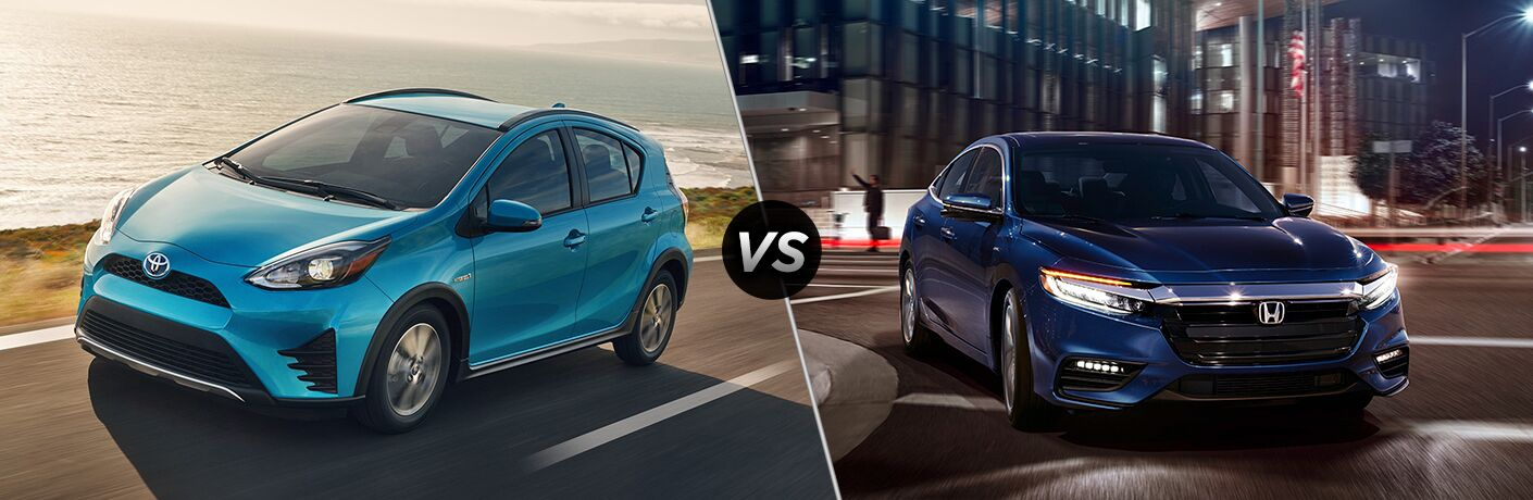 Blue 2019 Toyota Prius c on a Coast Road vs Blue 2019 Honda Insight on a City Street at Night