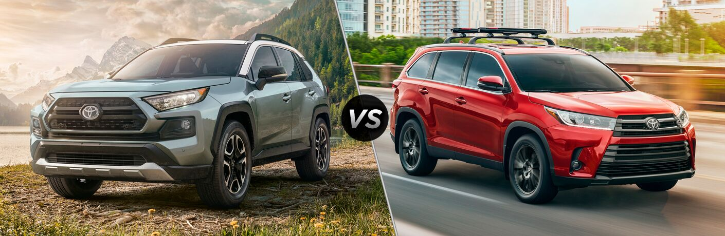 Gray 2019 Toyota RAV4 Front Exterior in Mountains vs Red 2019 Toyota Highlander on the Freeway
