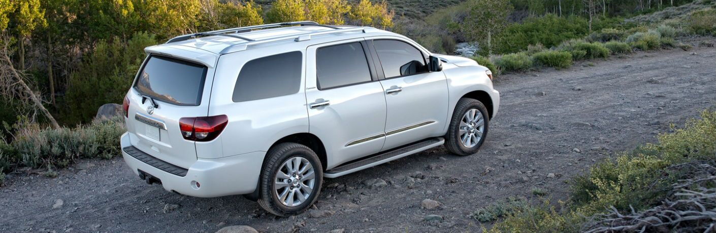 White 2019 Toyota Sequoia Rear Exterior on a Gravel Trail