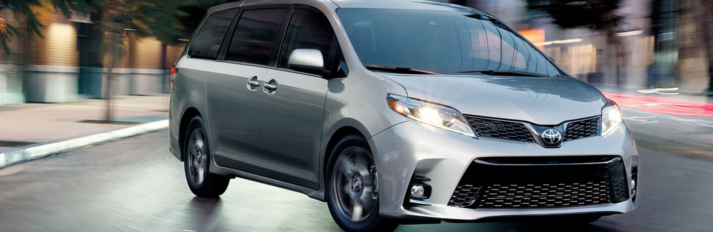Silver 2019 Toyota Sienna on a City Street at Night