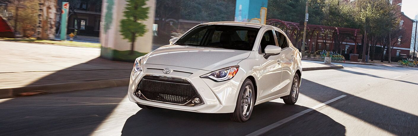 White 2019 Toyota Yaris Sedan Exterior Driving on City Street