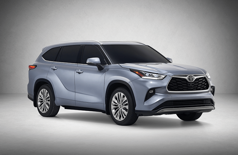 Blue 2020 Toyota Highlander Front Exterior on Gray Background
