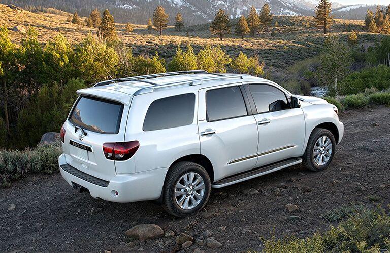 White 2020 Toyota Sequoia Rear Exterior on Rocky Trail