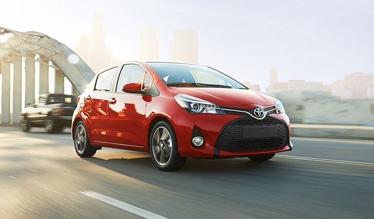 Red 2016 Toyota Yaris on Highway