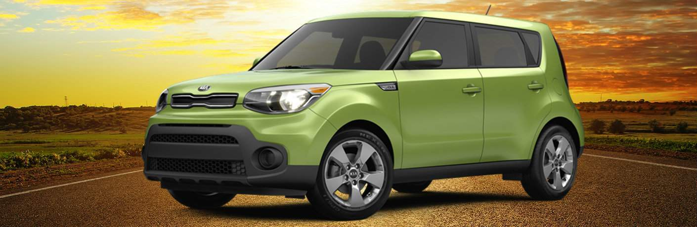 Green 2018 Kia Soul with Sunset in the Background