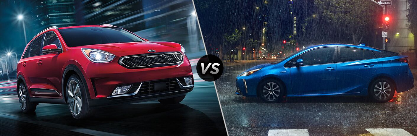 Red 2019 Kia Niro, VS icon, and blue 2019 Toyota Prius