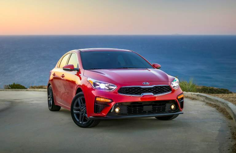 Red 2019 Kia Forte with Ocean in the Background