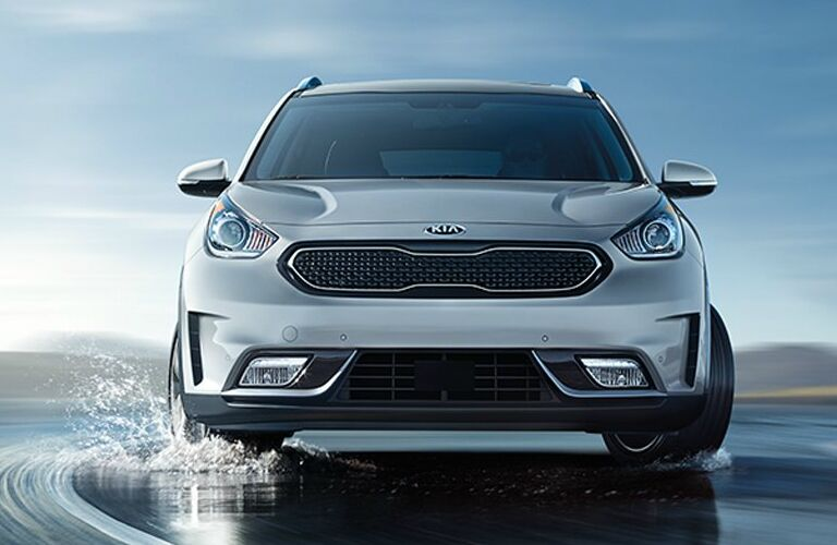 Silver 2019 Kia Niro Driving on a Wet Road