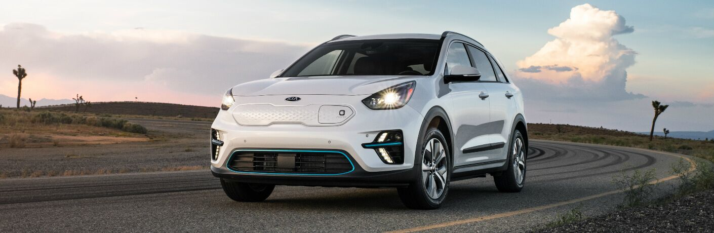 White 2019 Kia Niro EV with Joshua trees in the background