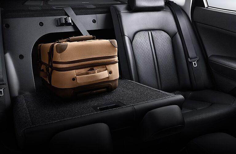 Luggage on a folded-down rear seat in a 2020 Kia Optima Hybrid