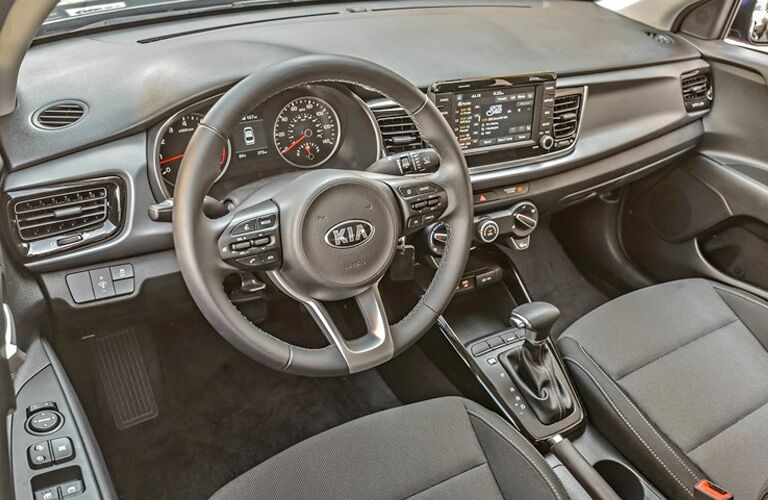 Grey dashboard and front seats in 2020 Kia Rio