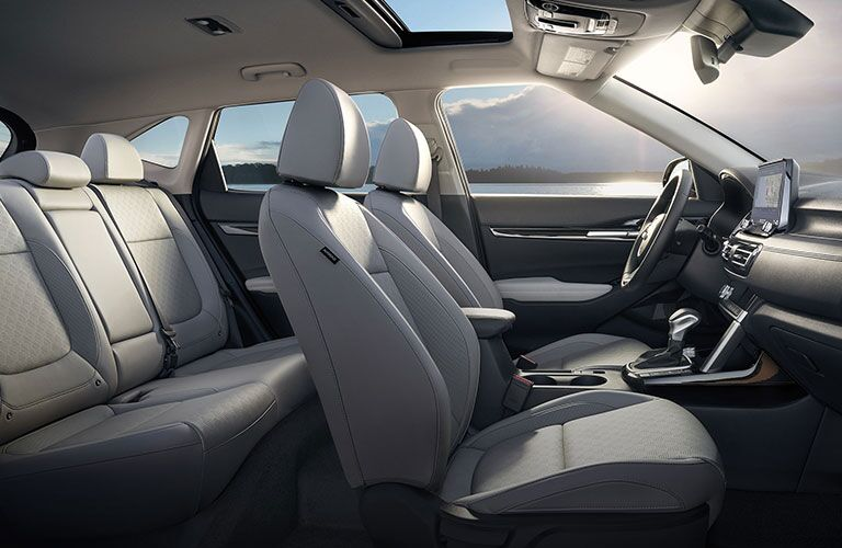 2021 Kia Seltos interior side shot of seating rows, upholstery, and overhead sunroof