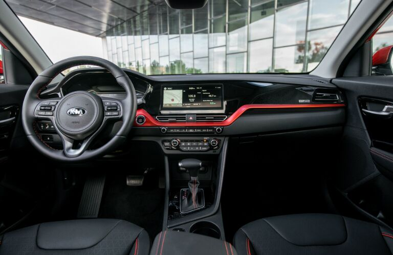 Black and red dashboard and front seats in 2020 Kia Niro