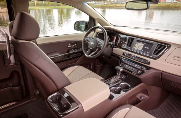 Brown and beige dashboard and front seats in 2020 Kia Sedona