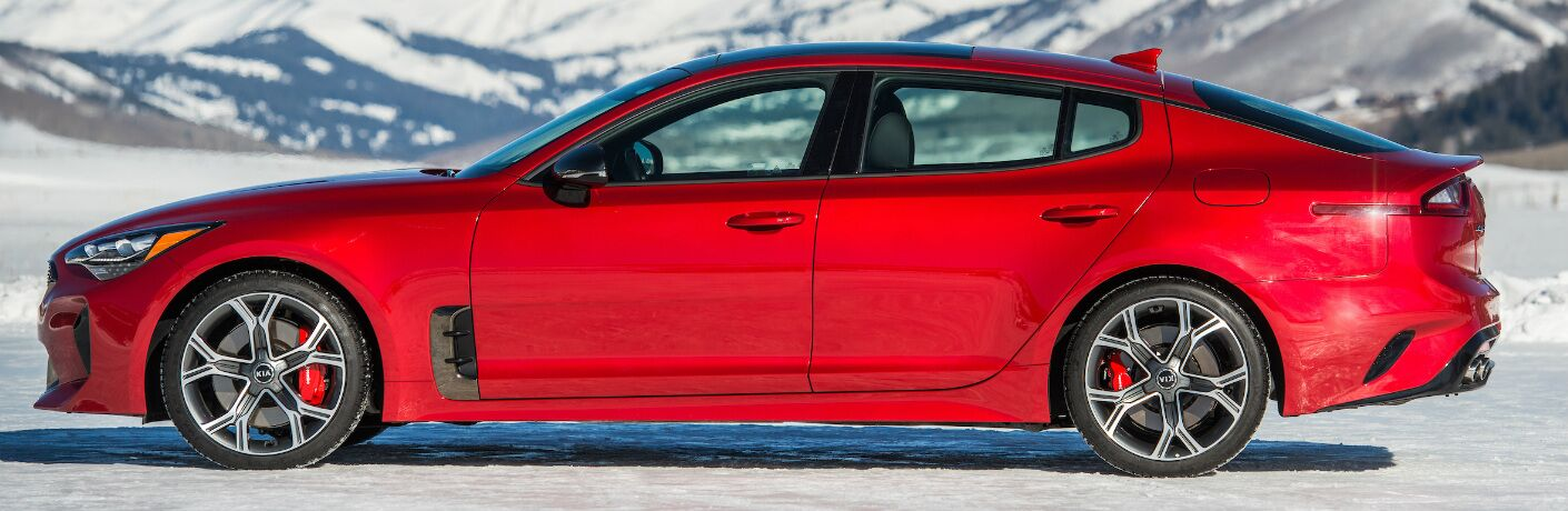 Red 2020 Kia Stinger parked on snowy terrain